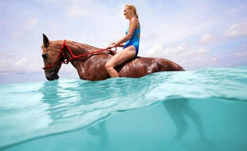 1Girl_in_a_bathing_suit_riding_a_horse_in_water.jpg