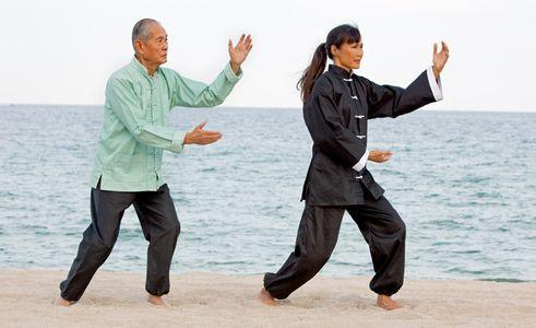 1Asian_man_and_woman_practising_Tai_Chi.jpg