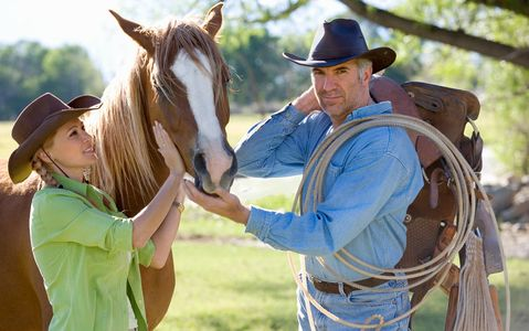 1Cowboy_couple_with_their_horse.jpg
