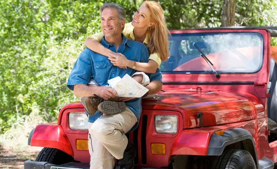 1Outdoor_couple_sitting_on_a_jeep.jpg