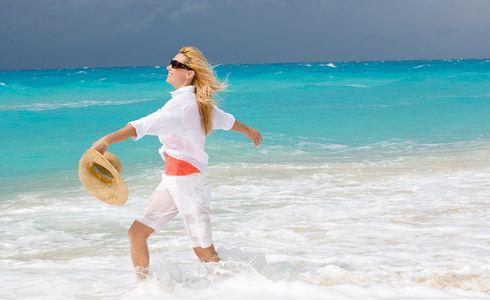 1Carefree_woman_walking_in_the_beach_surf___Copy.jpg
