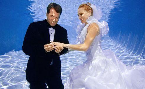 1Bride_and_groom_admire_her_ring_underwater.jpg