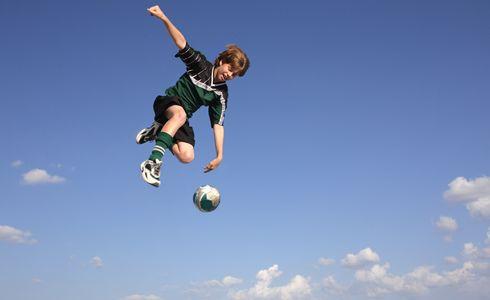 1Boy_kicking_soccer_ball_in_the_sky.jpg