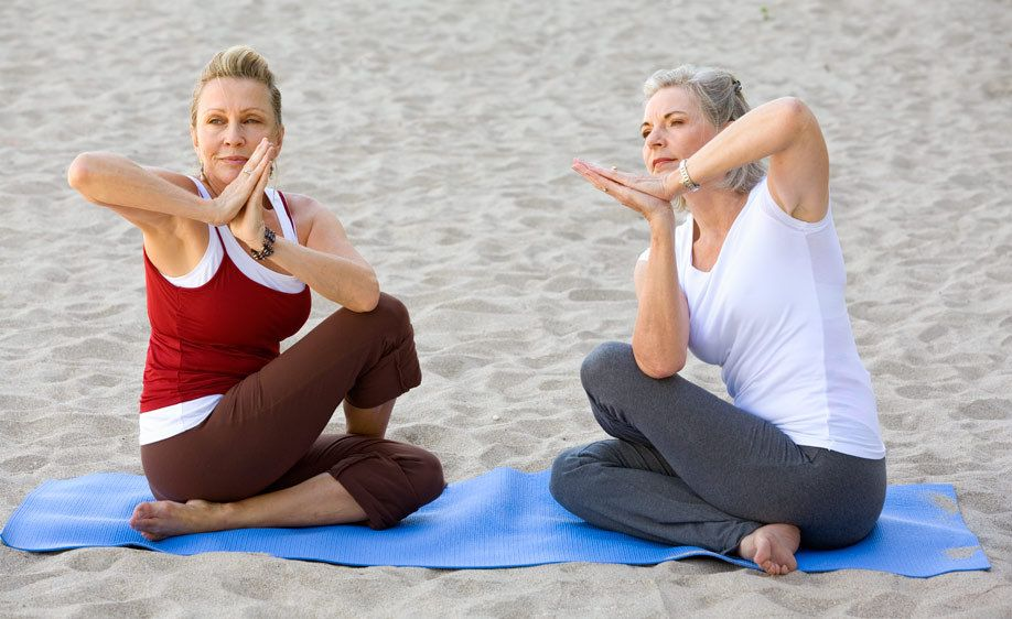 1Two_senior_woman_doing_yoga_on_the_beach.jpg