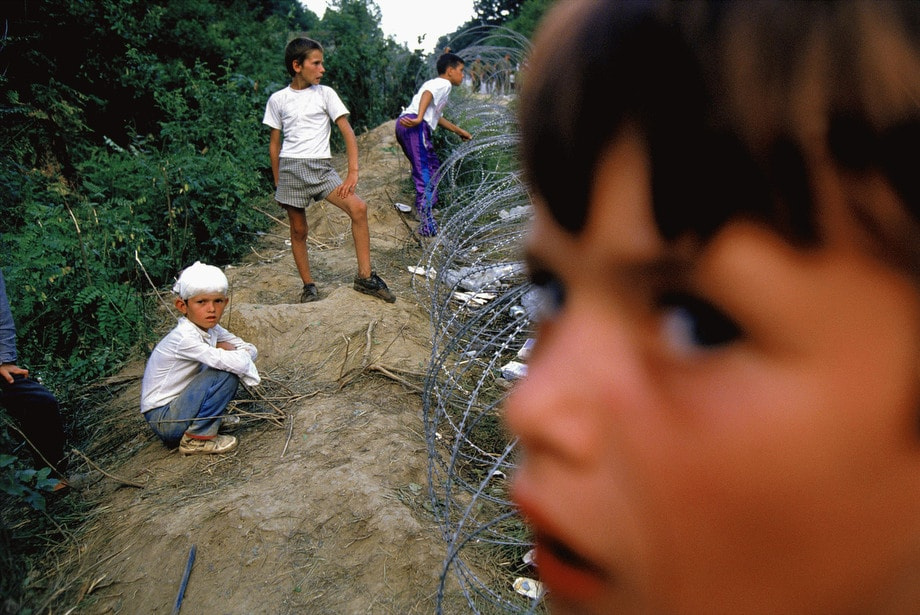 Children survivors of the attack on the United Nations Safe Haven in Srebrenica wait in a refugee camp in Tuzla, Bosnia.  © Ron Haviv - VII