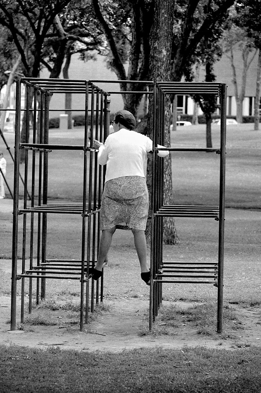 155-Woman-on-monkey-bars.jpg