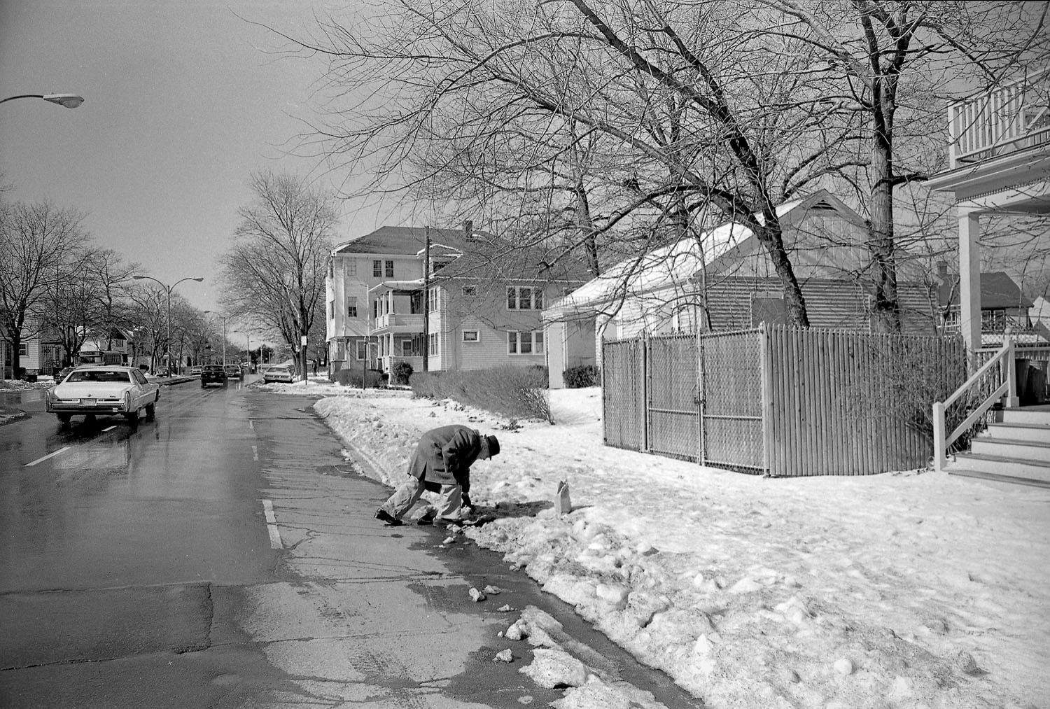 Man Climbing Snow Bank