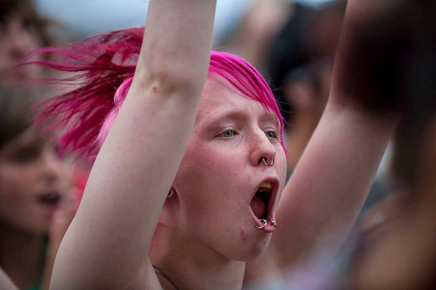 Woman with pink hair yelling