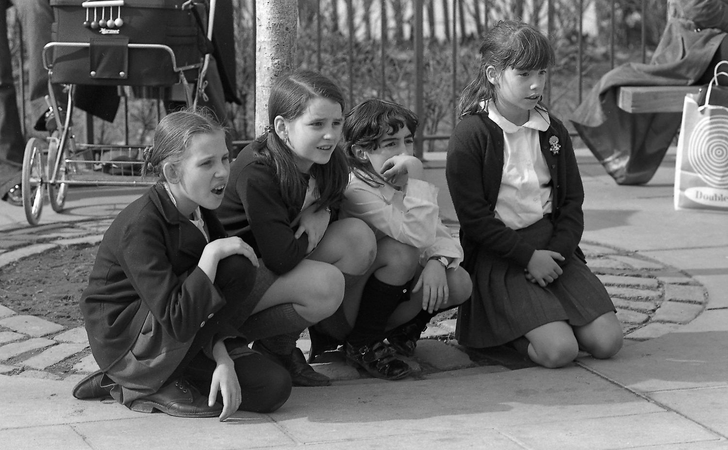 Girls Watching Street Performer