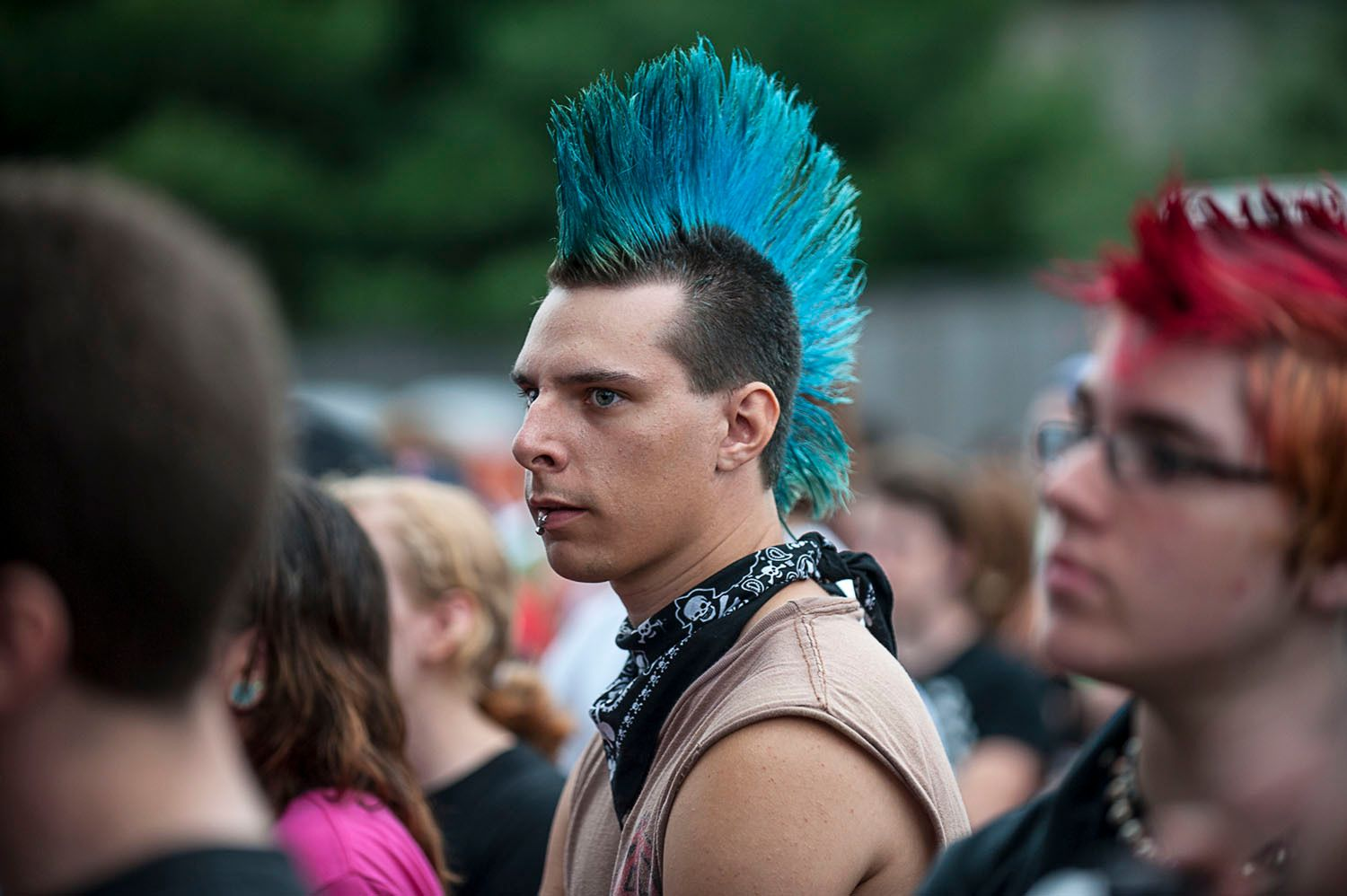 Man with blue mohawk haircut