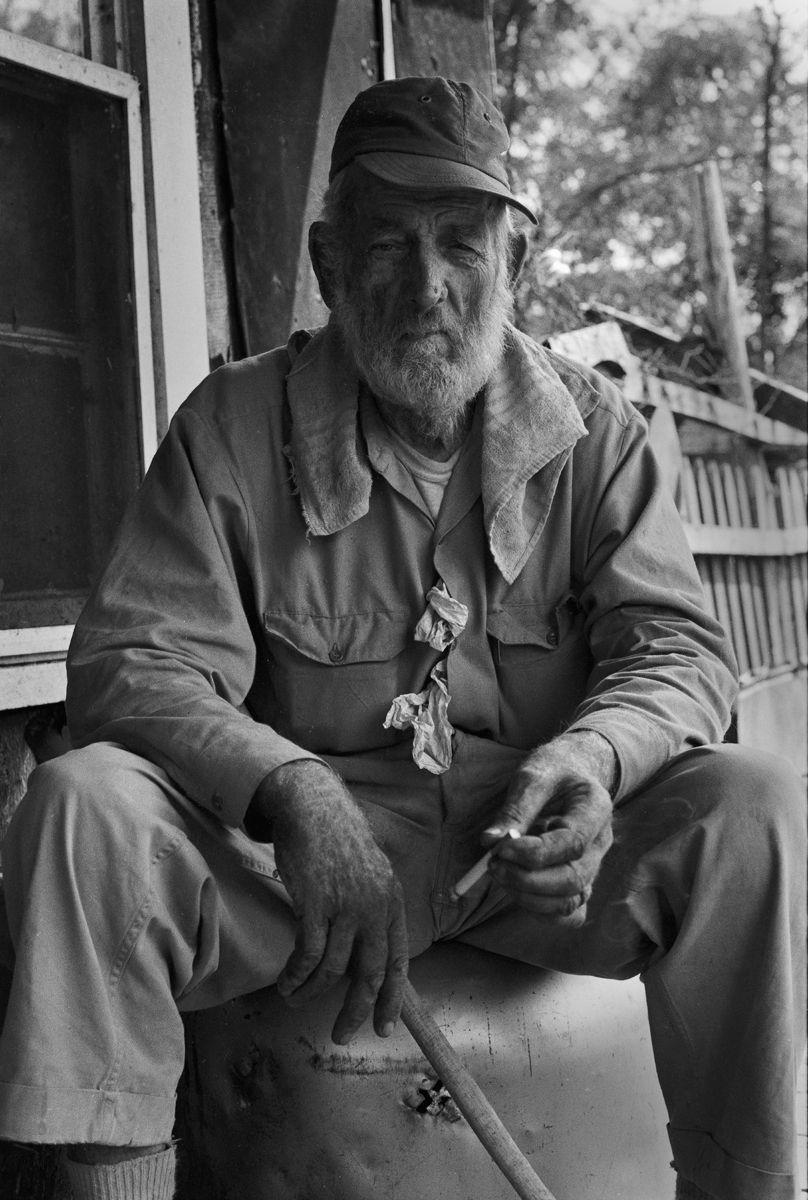 Old Man Smoking Cigarette