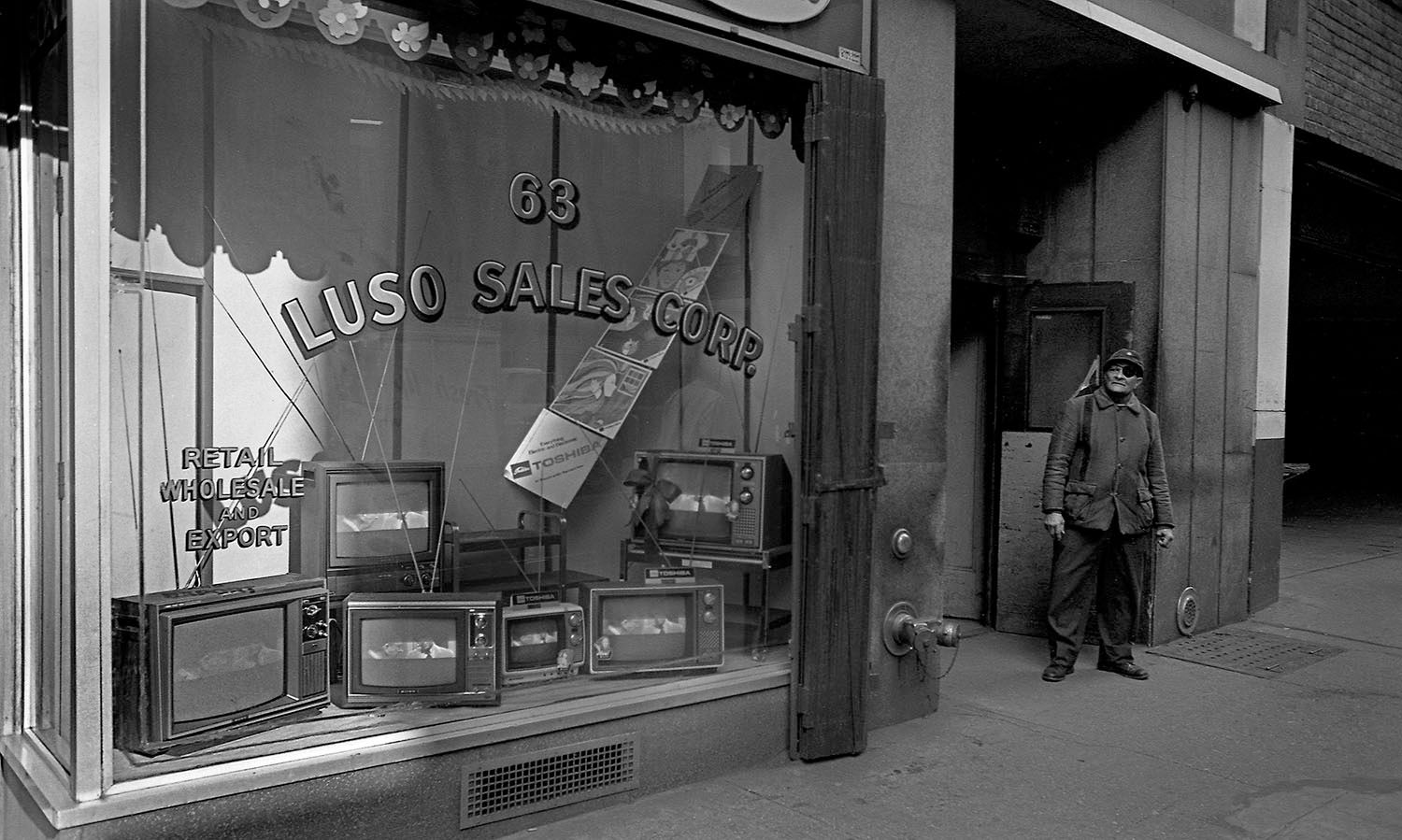 TV Store Window, NYC. NY 1975