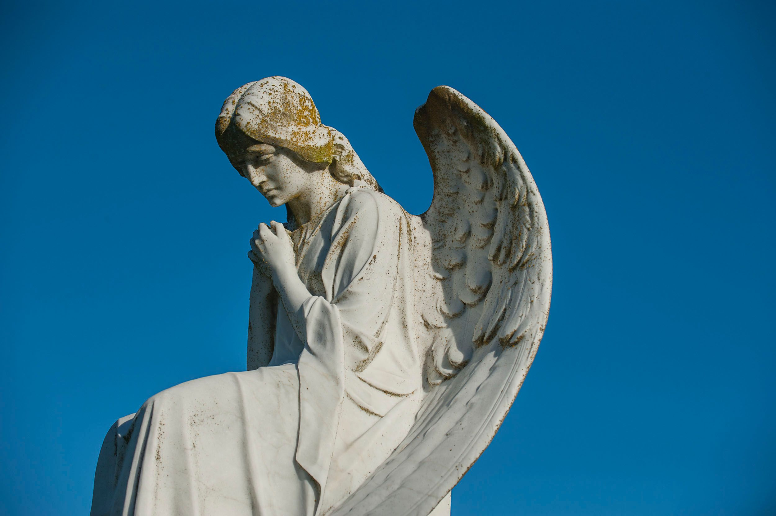 Marble Angel against Blue Sky