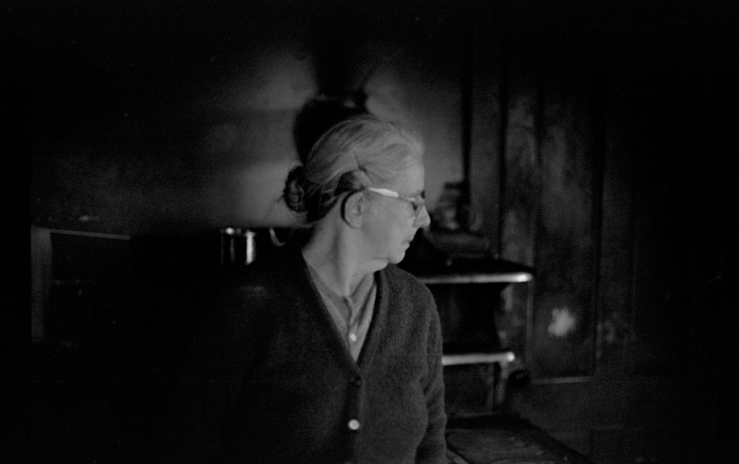 Portrait of woman inside with wood stove