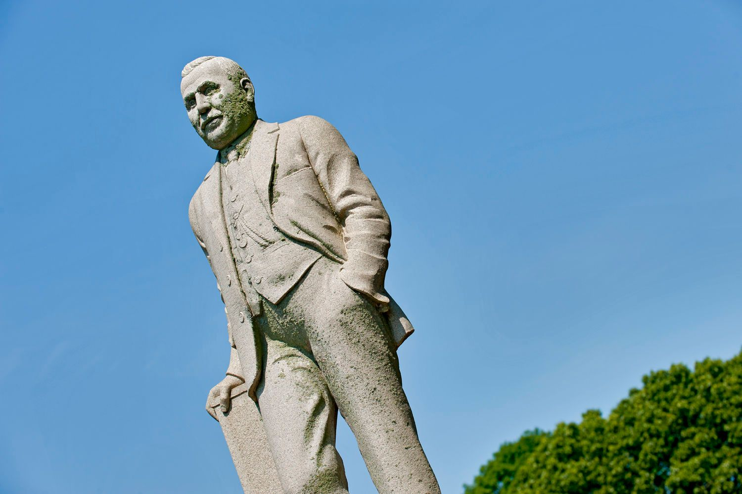 Statue of a Man Standing in Full Formal Attire