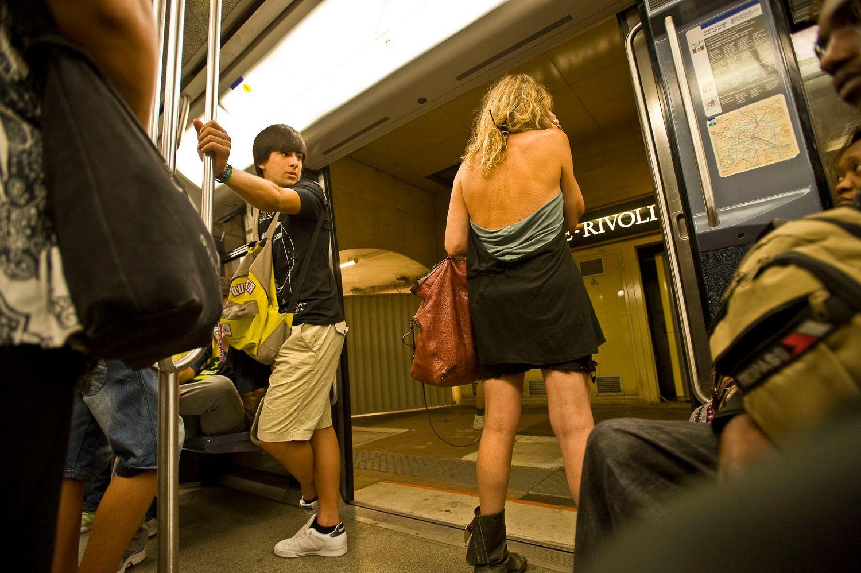 Young man looking at sexy woman on Paris subway car
