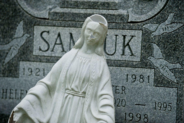 Broken Cemetery Statue