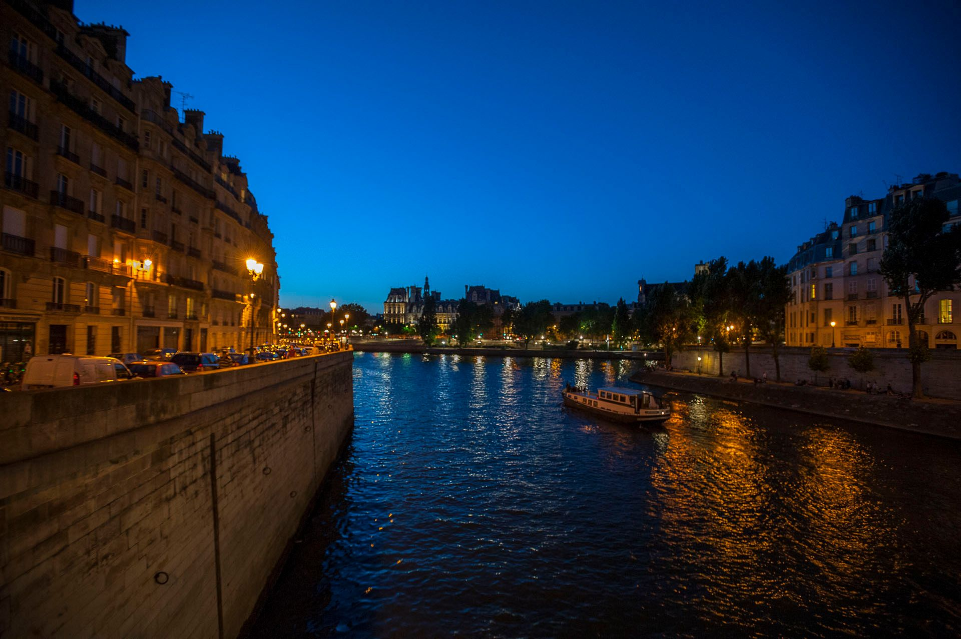 The Seine with boat in Paris, France
