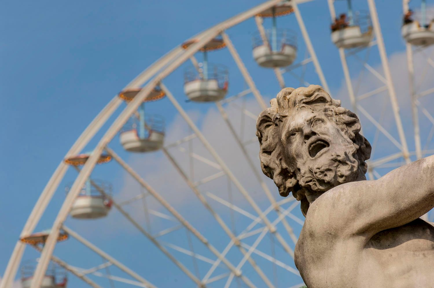 Statue in front of Ferris Wheel in Paris, France