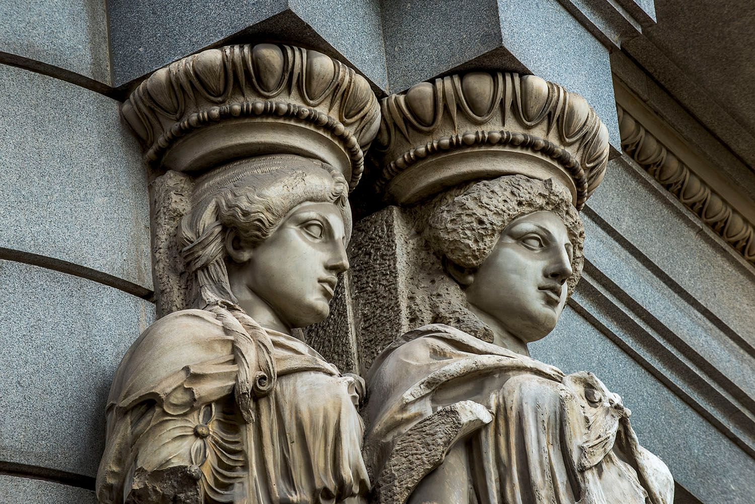 Statues on exterior of building