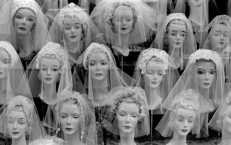 Mannequins Heads in Store Window