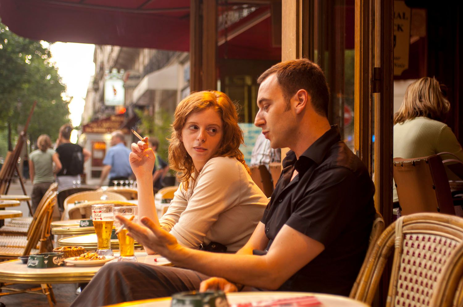 Couple Sitting at Outdoor Cafe in Paris