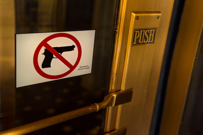 No Handguns Sign on Door