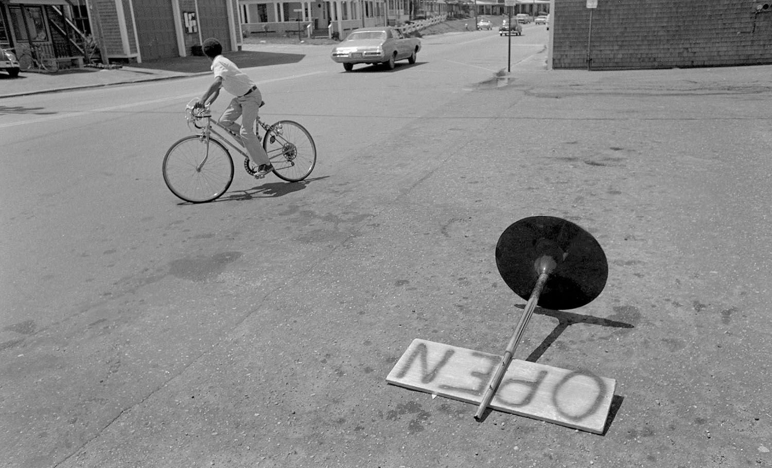 Fallen Sign and Bicyclist