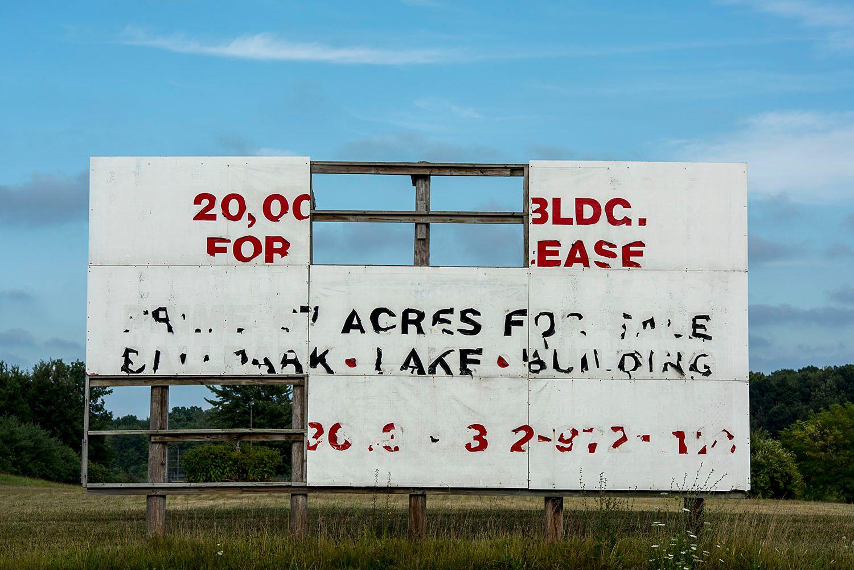Real Estate Bill Board in Disrepair