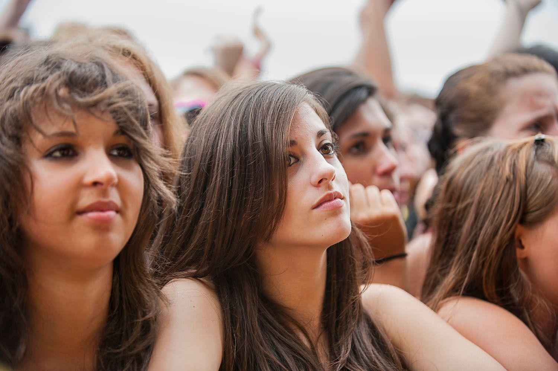 Young women watching the mucisians