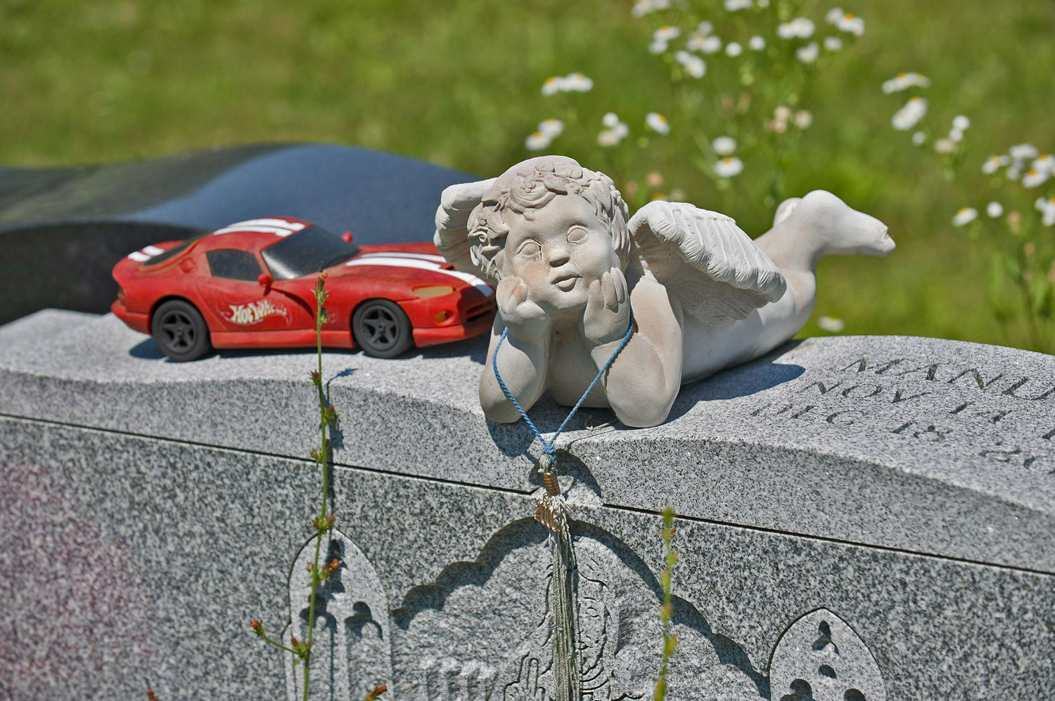 Angel and Plastic Car on Gravestone