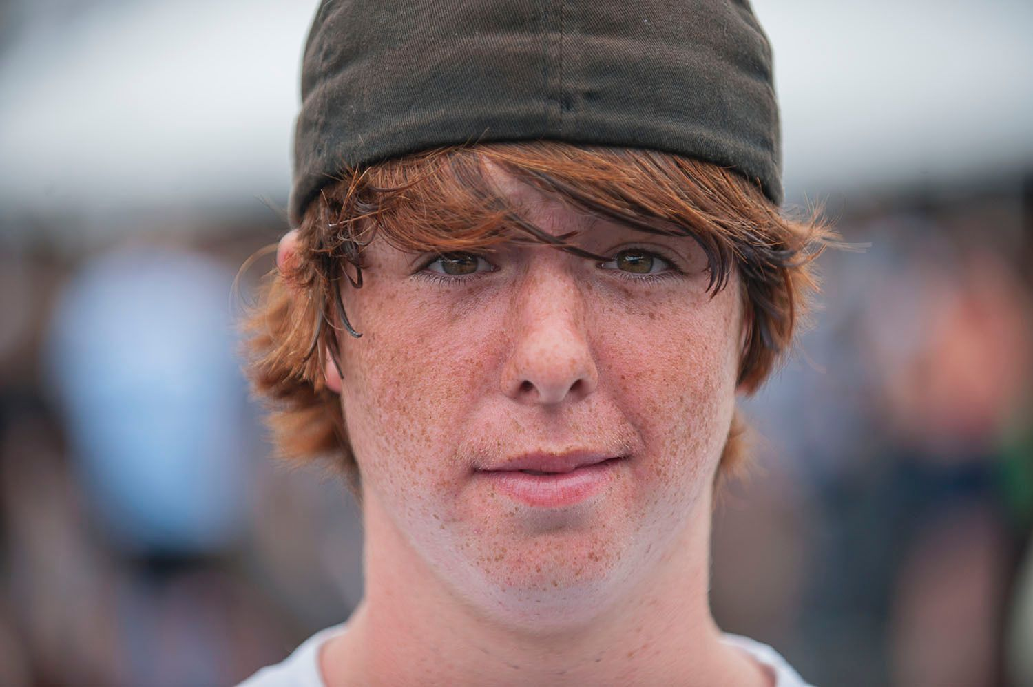 Young man with red hair and freckles and hat