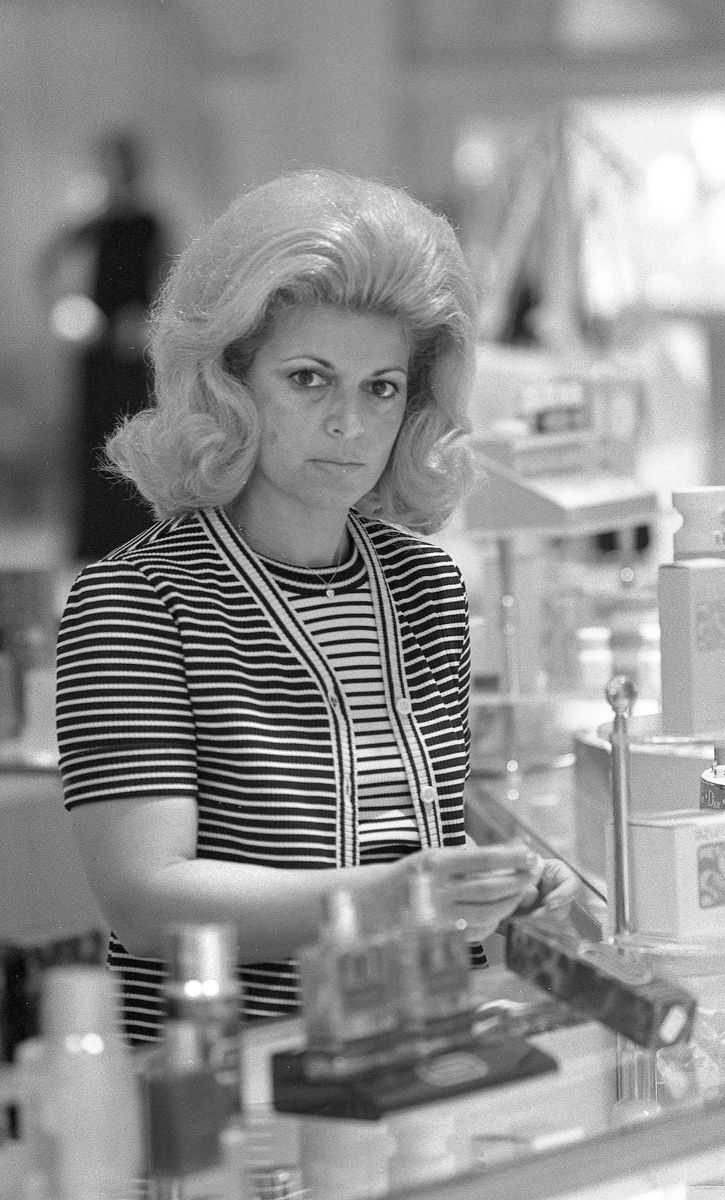Woman working at Cosmetic Counter in Department Store