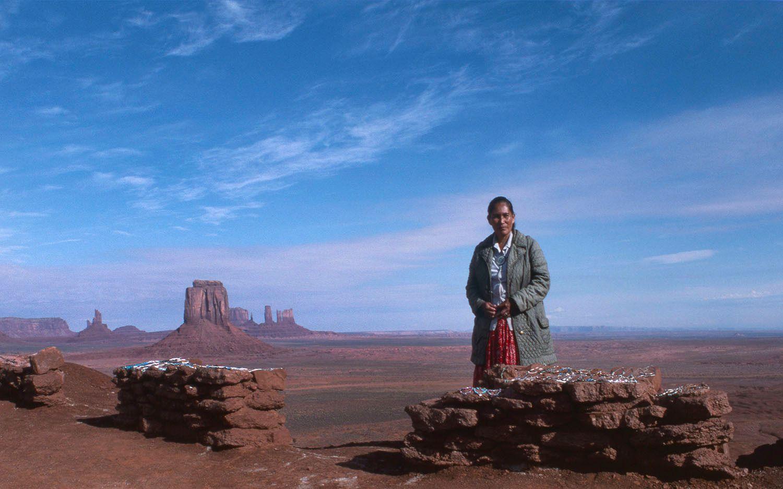 Navajo  woman selling jewelry