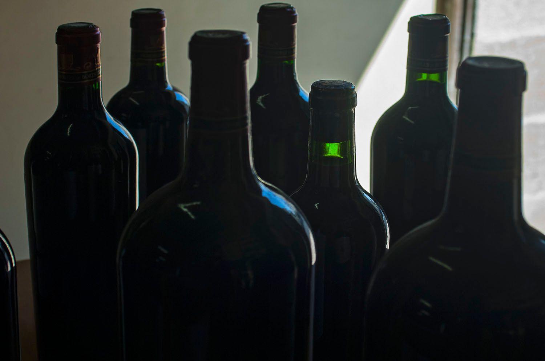 Bottles of unlabeled wine, Bordeaux, France