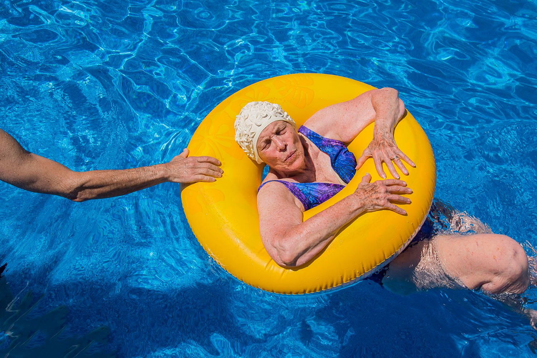 Marion Edson in Inner tube in swimming pool