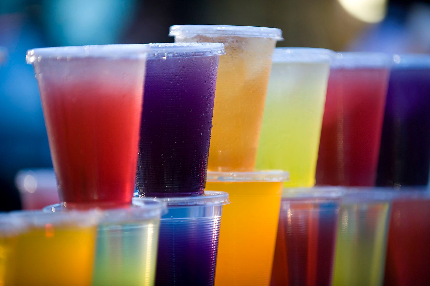 Colored Fruit Drinks in Plastic Cups