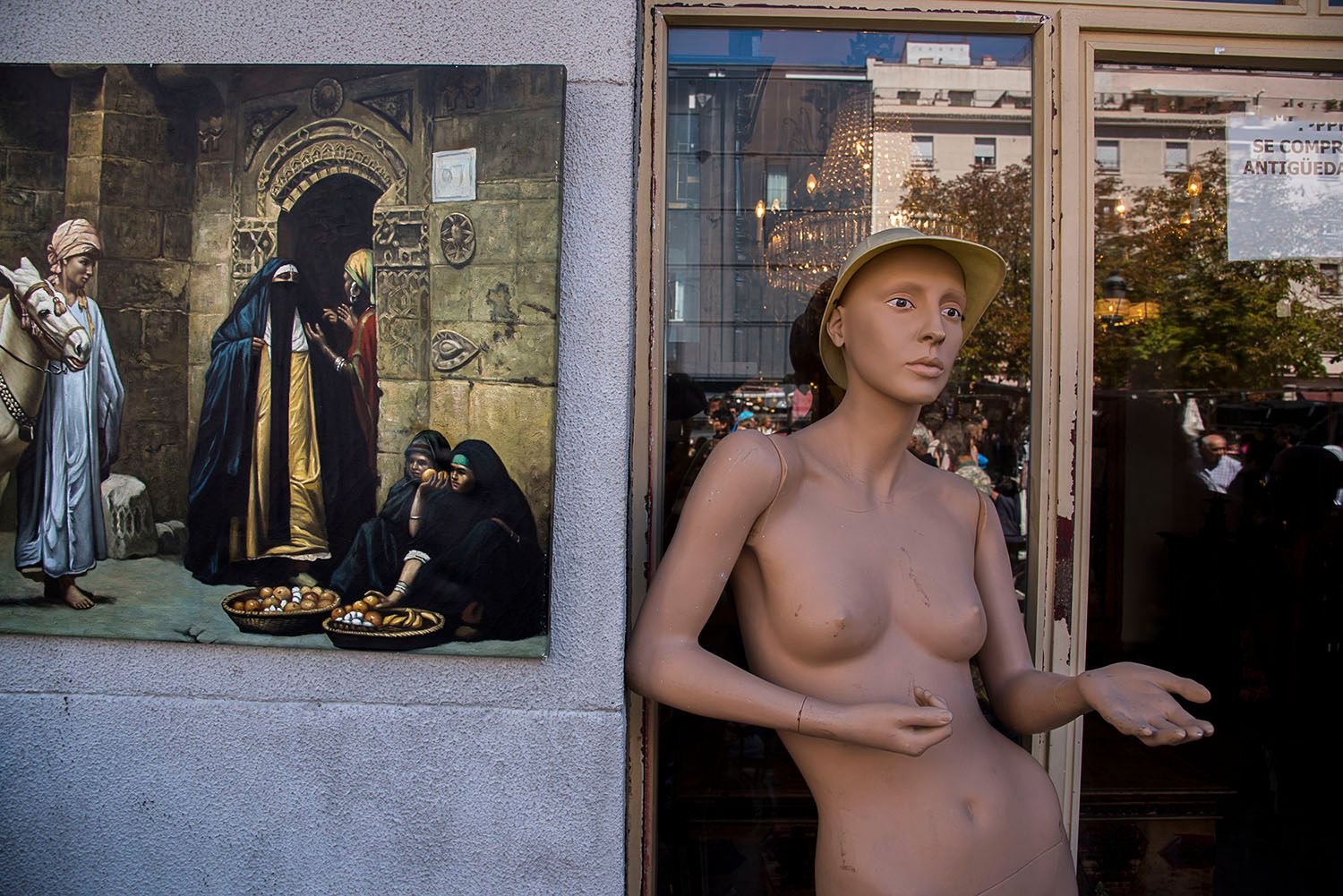 Nude female mannequin wearing a hat