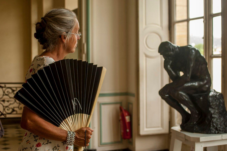 Woman with fan in Rodin Museum, Paris, France