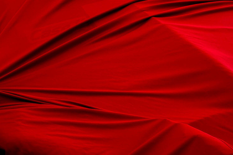 Red Tarp Covering Car