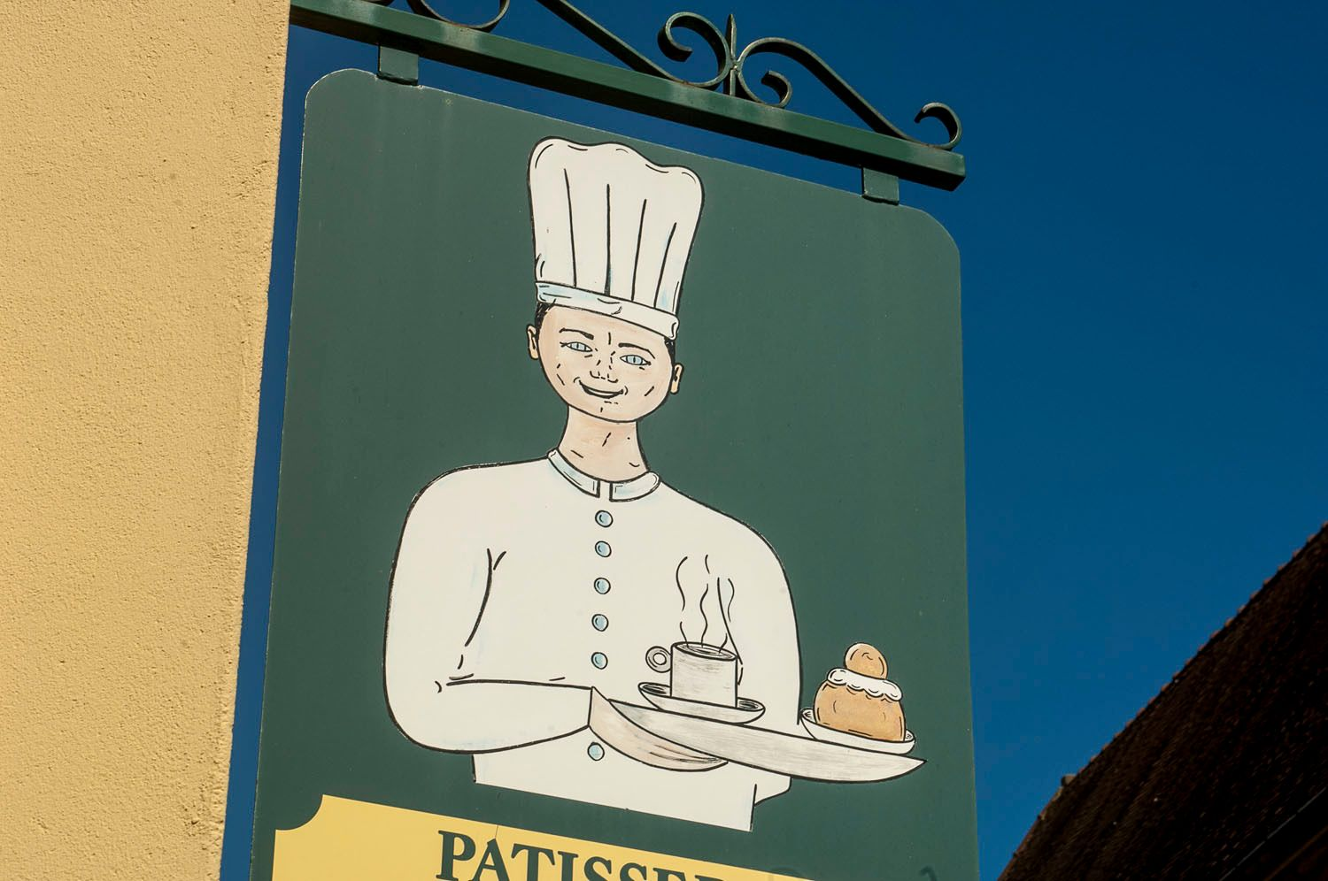 Cafe Sign with Baker, Beaune, France