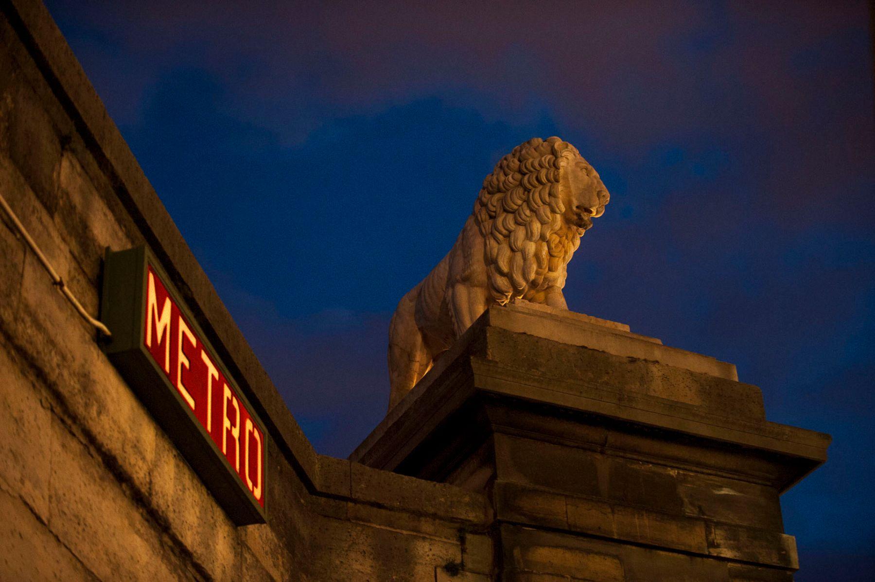 Lion statue and Metro stop, Place de la Concorde, Paris, France