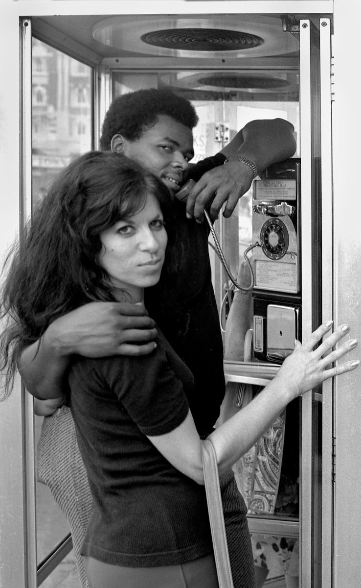 Man and Woman in Phone Booth,