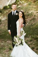 Bride with Bouquet and Groom outside on Mountain