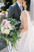 Bride and groom with bouquet for close up