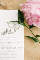 Wedding invitations with rings and flowers