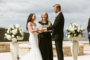 Mountainside wedding ceremony with flowers