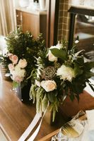 Bouquets in vases before wedding ceremony