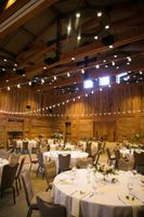 Wedding reception room with tables and centerpiece