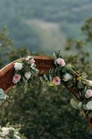Wedding ceremony circle arch florals